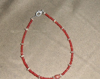 red and metal bracelet
