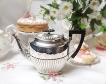A very elegant silver plated tea pot: High quality silver plate ribbed teapot with black bakelite handle and knob. Very Downton Abbey