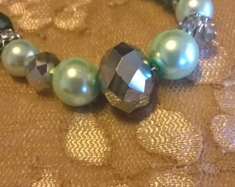 "Handmade 22"" teal pearl necklace with multi-faceted bead accents"