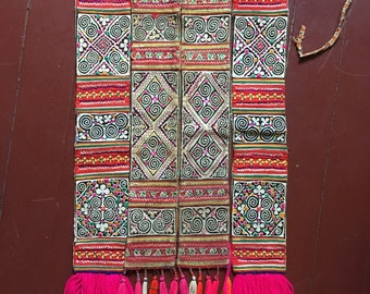 Vintage Hmong textile. Reverse appliqué, applique and embroidery. Skirt overlay panels