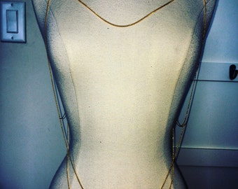three-tiered gold body chain