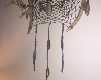 One of a kind antler dream catcher with a petoskey stone center
