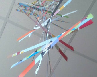 Geometric mobile out of colorful paper strips. Modern