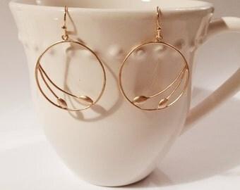 gold seedling hoop earrings