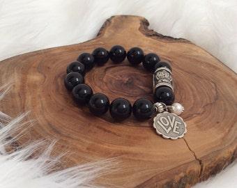 Black Onyx Bracelet with Silver Charms