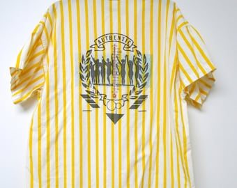 "Ocean Pacific / OP . 1987 yellow and white stripes . button down . loose fit shirt . fits a large to extra large . bust 48""made in USA"