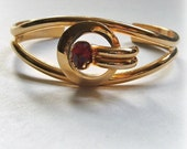 Cuff Bracelet Vintage Modernist, Red Glass Stone, gold tone costume jewelry