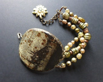 Rotterdam. Rustic assemblage bracelet with salvaged tin and vintage glass pearls.
