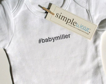 hashtag baby... baby bodysuit pregnancy announcement