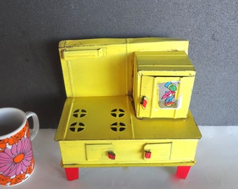 Vintage Tin Toy Stove Jiminy Cricket Sticker On Door Yellow Red Some Wear 7.5 Inches Tall X 8 Inches Long X 4.5 Inches Wide