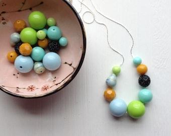 destination wedding necklace - vintage lucite - earthtones - lime ochre blue