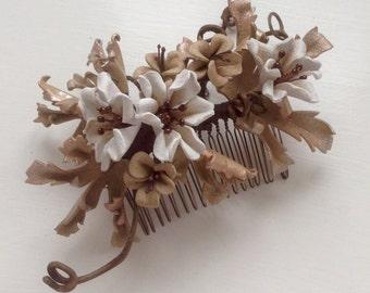 White burnished bronze comb