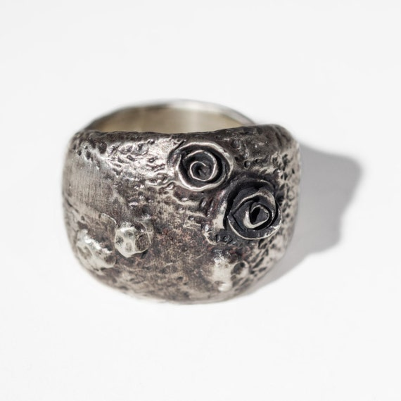 "volcanic texture oxidized silver dome ring with roses.  ""growth prevails"""