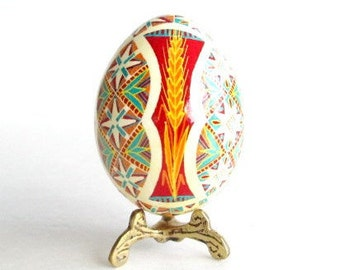 Turquoise and red Pysanka, batik egg on chicken egg shell, Ukrainian Easter egg, hand painted egg