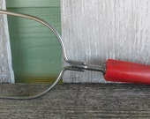 Vintage Red handled bakelite potato masher