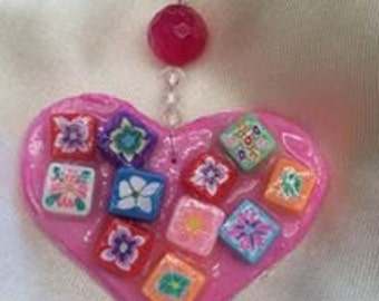 Bright pink heart necklace with flower beads