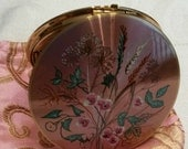 Stratton Powder Compact; 'Scone/Regal'; Featuring A Floral Motif On A Pinkish Purple Enameled Background Circa 1950's-1970's-  DR199