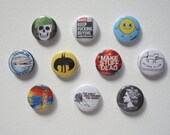 Badges - illustrated pin bagdes from Spelling Mistakes Cost Lives