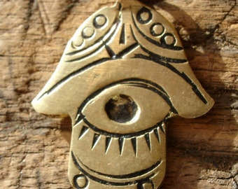 Moroccan small shiny gold colour hand pendant with eye