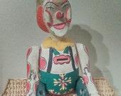 Vintage wooden clown piggy bank.  1950's wood clown bank with movable limbs. Antique wood clown bank.