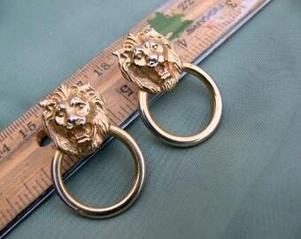 llion head post earrings