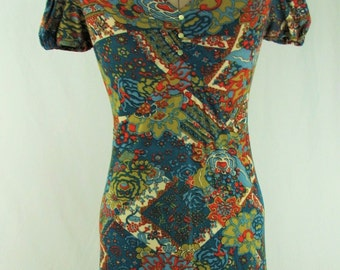 Vintage 1970s Long Comfy Maxi Dress With Cap Sleeves And A Floral Psychedelic Print in Blues, Gold, Burnt Orange and Cream