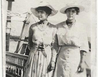 Old Photo 2 Women wearing Dress Hats Skirt on Dock 1910s Photograph snapshot vintage