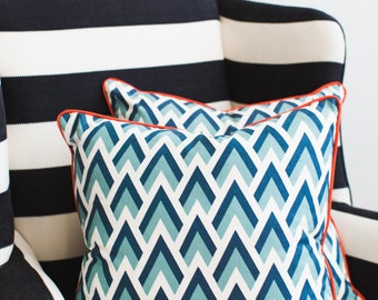 20x20 Throw Pillow Blue Geometric Pattern with Orange Coral Piping