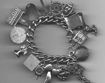 Sterling 925 heavy link ladies charm bracelet loaded with antique charms