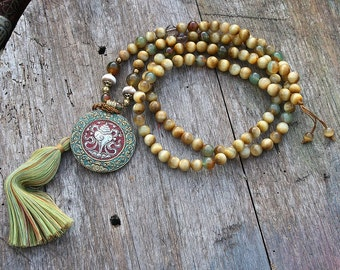 Beautiful butter yellow tiger eye gemstone mala necklace decorated with a Nepalese pendant