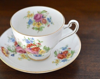 Tea Cup and Saucer Queens Royal Multi Colored Flowers Bone China England