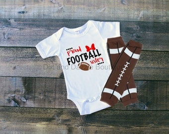 Proud football sister bodysuit with matching football leg warmers and optional red hair bow