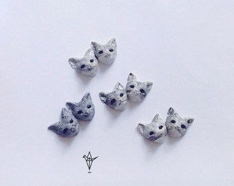 Earrings with gray foxy.
