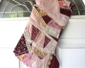 Christmas stocking, crazy quilt style using different fabrics and laces to create the top.  Length 15 3/4 inches, width at top 7 1/2.