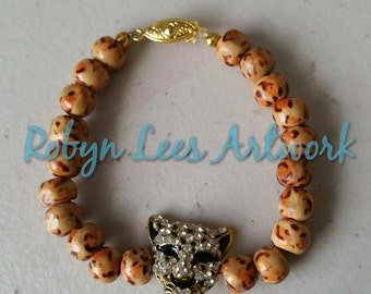 Wooden Leopard Print Beaded Bracelet with Gold and Crystal Rhinestone Leopard Head and Gold Box Hook Clasp