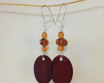 brown glass and shell drops