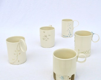 handmade porcelain cups with crazy handles
