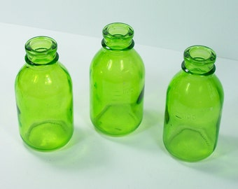 Green glass apothecary bottles by 3 marking 100 vintage