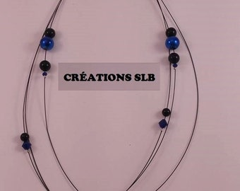 Black Blue Star on tigertail necklace