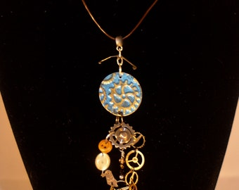 Crafted metal and steampunk pendant