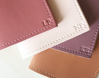 Embossed initials (must also order passport holder separately*)