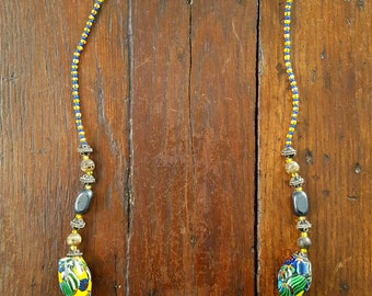 Colourful moroccan necklace, glass beads and a cross.