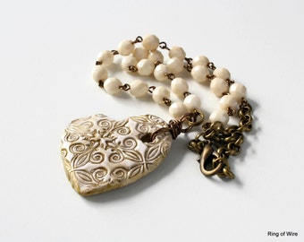 Off White Heart Necklace, Antiqued Gold Necklace, Clay Heart Necklace, Polymer Clay Jewelry, Fleur de Lis Heart Pendant, Cream Bead Necklace