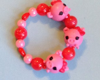 Three Little Pigs - Lalaloopsy Pink Piglet Stretch Bracelet with Chunky Red Beads