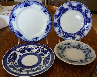 4 Flow Blue Plates in various patterns