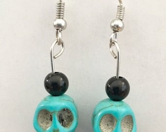 Turquoise colored skull earrings