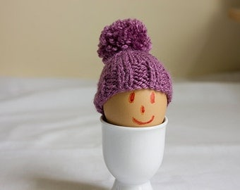 Egg Cosy in a grape colour yarn, egg warmers, egg hat