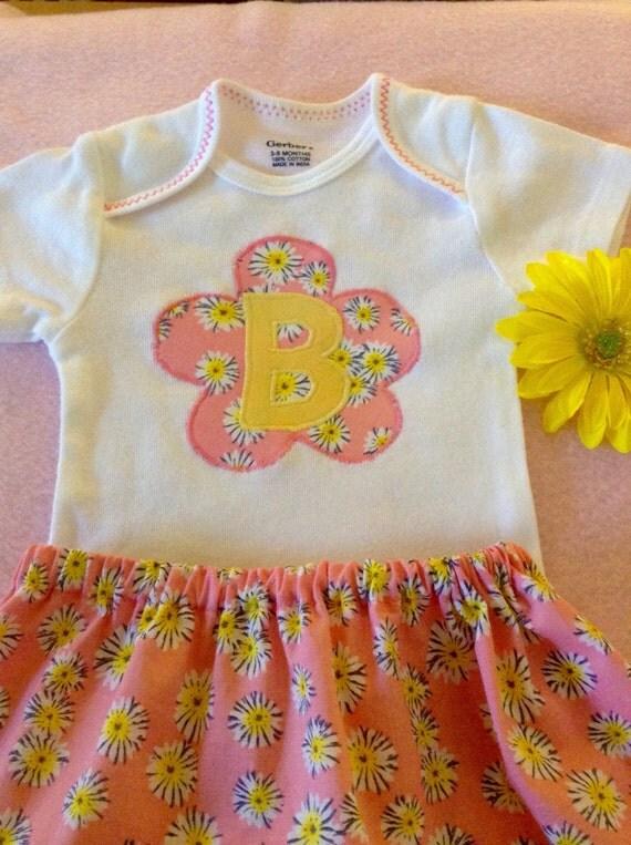 Initial flower appliqué onesie, skirt, bib, or burp cloth set monogramed for baby girl