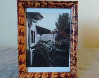 Vinegar painted wood picture frame in sienna