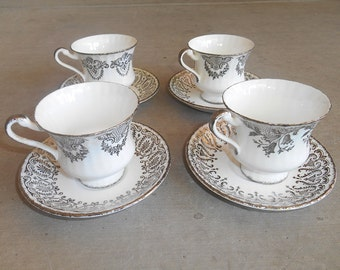 Set of Four Mid-Century Teacups and Saucers